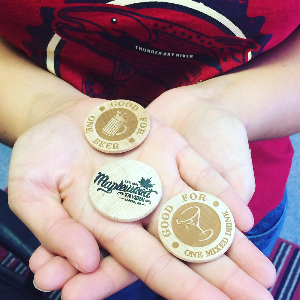 Wooden coins with logos on them